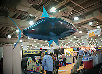 "A helium-filled remote controlled ""Air Swimmers"" Great White Shark floats above the William Mark Corp. booth at the 111th American International Toy Fair in the Jacob Javits Convention center in New York on Monday, February 17, 2014.  The four day trade show with over 1000 exhibitors connects buyers and sellers and is expected to draw tens of thousands of attendees.  The toy industry generates  $22 billion in the United States and Toy Fair is the largest toy trade show in the Western Hemisphere. (© Richard B. Levine)"