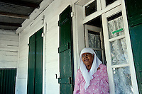 Aveea at door to her home in Mahebourg.