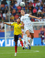 Lauren Cheney (r) of team USA and Liana Salazar of team Colombia during the FIFA Women's World Cup at the FIFA Stadium in Sinsheim, Germany on July 2nd, 2011.