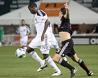 Dejan Jakovic #5 of D.C. United loses the ball to Edson Buddle #14 of the Los Angeles Galaxy during an MLS match at RFK Stadium on July 18 2010, in Washington D.C. Galaxy won 2-1.