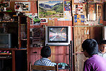 Kids play video games on Wednesday, Apr. 8, 2009 in Ventanilla, Peru.