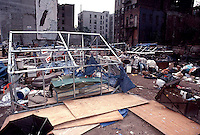 A vacant lot on East Eighth St. in the East Village in 1991. Squatters and the homeless took over the lot as their encampment. The lot has just been cleared out by the NYPD and is to become a community garden.  (© Richard B. Levine)