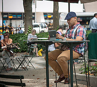 A visitor to Bryant Park in New York uses his iPad on Wednesday, July 31, 2013.  (© Richard B. Levine)