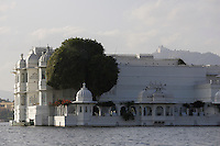 Lake Palace luxury hotel on the Island of Jag Niwas in Lake Pichola, Udaipur, India. Used as a set for the James Bond Film / movie Octopussy