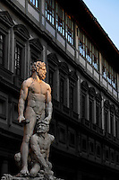 Low angle view of statue of Hercules and Cacus, 1525-34, by Bandinelli, Piazza della Signoria, Florence, Tuscany, Italy, pictured on June 9, 2007, in the afternoon with the Uffizi Gallery in the background. The statue of Hercules and Cacus by Baccio Bandinelli (1525-34) was originally commissioned from Michelangelo as a pair to the David statue, and the re-assignment to Bandinelli was highly controversial; but the Medicis were satisfied and rewarded Bandinelli richly. The sculpture represents physical strength in contrast to David's spiritual strength. Florence, capital of Tuscany, is world famous for its Renaissance art and architecture. Its historical centre was declared a UNESCO World Heritage Site in 1982. Picture by Manuel Cohen.
