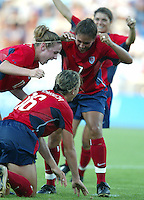 14 August 2004:   USA Heather O'Reilly and Shannon Boxx celebrate with Abby Wambach after Wambach scored a goal against Brazil at Kaftanzoglio Stadium in Thessaloniki, Greece.   USA defeated Brazil, 2-0. Credit: Michael Pimentel / ISI