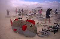 A fish bike is abandoned as people take cover from the harsh winds of a sandstorm at the annual, weeklong Burning Man Festival held.  The counter-culture event celebrates art on public land in the Black Rock Desert in northwestern Nevada's Conservation area.
