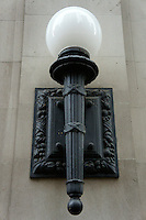 Electric lamp on the side of a heritage building in Vancouver, BC, Canada