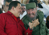 Venezuelan President, Hugo Chavez, pictured with Fidel Castro as he visits the Havana International Book Fair in Havana, Cuba on March 2, 2006. Credit: Jorge Rey/MediaPunch