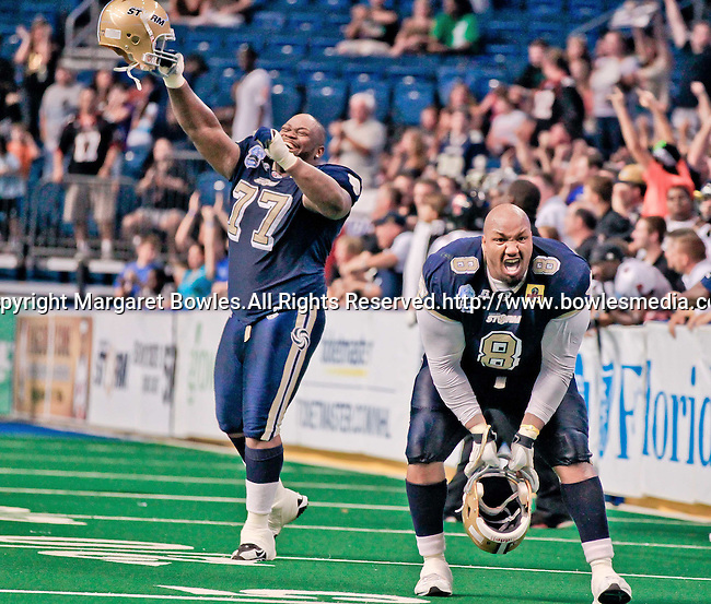 Aug 14, 2010:  Tampa Bay Storm defensive lineman Tim McGill (#8) and Brandon Hefflin (#17) celebrate a Storm division championship over the Orlando Predators. The Storm defeated the Predators 63-62 to win the division title at the St. Petersburg Times Forum in Tampa, Florida. (Mandatory Credit:  Margaret Bowles)