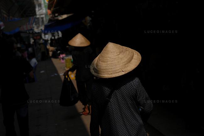 Vietnamese women walk to the market in Ho Chi Minh City, Vietnam.