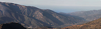 General view of the mountains with the Mediterranean Sea in the distance, Alpujarra, Sierra Nevada, Andalucia, Southern Spain. Photograph by Manuel Cohen.