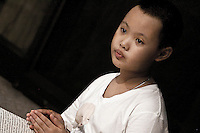 A young Thai nun attends the evening meditation program at the Sathira Dhammasathan meditation centre. She is one of the novice Thai nuns whose were ordained as nun last year as part of the yearly ordination program of the Centre for female young nuns to raise awareness of nuns in the Thai nation. The temporary ordination of ?mae chee? or ?nuns? is not common in Theravada societies, and the idea that women should not play an active role in monastic life still prevails among more conservative Thais.
