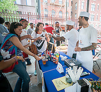 The busy YourPanadas stand at the kick-off of the annual Vendy Plaza at  La Marqueta in the East harlem neighborhood of New York on Sunday, May 24, 2015. The plaza area, La Marqueta Retoña, hosts a weekly vendors market drawing on food entrepreneurs from the streets around the city. (© Richard B. Levine)