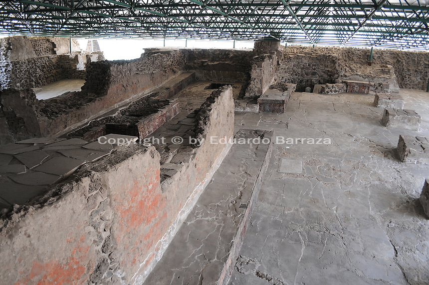 """Mexico City – The Templo Mayor, or """"Great Temple,"""" is located in the heart of Mexico City. Ancient greatness, unfinished history, and contemporary archeology converge in a city that blends the past and present in a never-ending journey of discovery and awe. The Great Temple was the religious hub of the Mexica people (better known as Aztecs). It was built within a """"sacred precinct,"""" in an unclosed area surrounding the temple. The ruins of the temple were discovered and began to be unearthed about three decades ago, after electric company workers accidentally found, in 1978, a big carved monolith beneath the street level. This surprising discovery triggered the excavation of full city block to which led to the amazing discovery of the Templo Mayor. The discoveries turned the area into an ongoing archaeological site where a museum was later built. Most recently, another monolith was found in a lot adjacent to the temple. The monolith discovered in October 2006 is now in display in the museum and it was determined to be a representation of Tlaltecuhtli, the Earth goddess in Aztec religion. Photo by Eduardo Barraza © 2011"""