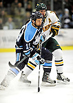 30 October 2010: University of Maine Black Bears' forward Spencer Abbott, a Junior from Hamilton, Ontario, in action against the University of Vermont Catamounts at Gutterson Fieldhouse in Burlington, Vermont. Abbott scored the game winner, as the Black Bears defeated the Catamounts 3-2 in sudden death overtime. Mandatory Credit: Ed Wolfstein Photo