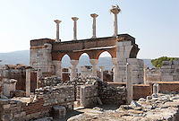 """Ruins of the Basilica of St John with the 2-storey narthex, built 536-565 AD under Emperor Justinian on the site of the apostle's tomb, Ephesus, Izmir, Turkey. St John the Evangelist spent his last years in Ephesus and died here. In the 4th century a church was erected over his tomb but in the 6th century Justinian ordered the construction of a large, 6-domed basilica built of stone and brick with marble columns in a Greek cross plan, the ruins of which we see today. The church measures 130x56m and was an important Christian pilgrimage site, attaining the status of """"Church of the Cross"""". The domes were over the central crossing, choir, transepts and nave. Five domes rested on solid piers in the corners of the cross and surmounted the arms and centre crossing, held in place by massive marble pillars. Storks now nest on the capitals of the columns on the upper storey of the nave arcade or narthex, seen here. The church interior would have been covered with frescoes, and the vaults with mosaics. An earthquake in the 14th century destroyed most of the building. Ephesus was an ancient Greek city founded in the 10th century BC, and later a major Roman city, on the Ionian coast near present day Selcuk. Picture by Manuel Cohen"""