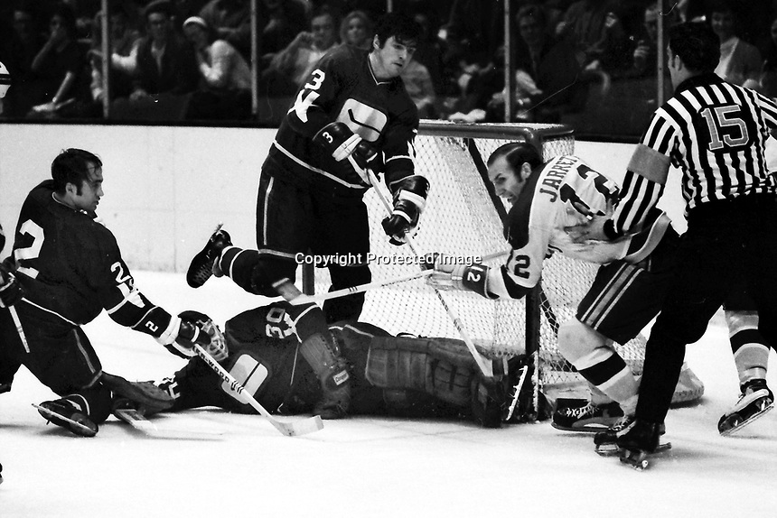 Seals vs Vancouver Canucks 1971. Gary Jarrett trying to score, Canucks Gary Doak, Pat Quinn help goalie Dunc Wilson or George Gardner. (photo/Ron Riesterer)