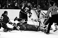 Seals vs Vancouver Canucks 1971. Gary Jarrett trying to score, Canucks Gary Doak, Pat Quinn help goalie Dunc Wilson or George Gardner. (photo/Ron Riesterer)