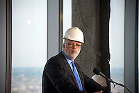 Port Authority of NY & NJ Executive Director Patrick Foye speaks at a ceremony as One World Trade Center becomes the tallest building in New York,  on Monday, April 30, 2012. Workers erect steel columns raising the height to over 1,250 feet, a tad above the Empire State Building. When finished the building will be 1,776 feet, the third tallest building in the world. (© Richard B. Levine)