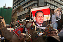 Egyptian protesters carry a photo of Egyptian President Hosni Mubarak during a  Pro-Mubarak march February 02, 2011in the Mohandiseen district of Cairo Egypt. Both pro and anti Mubarak sides faced off today, battling for control of Tahrir square , which has been at the center of more than a week of ongoing protests across Egypt. .(Photo by Scott Nelson)