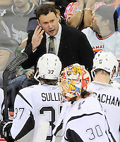 San Antonio Rampage head coach Chuck Weber talks to his players during the second period of an AHL hockey game against the Oklahoma City Barons, Friday, May 11, 2012, in San Antonio. (Darren Abate/pressphotointl.com)