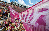 TALLAHASSEE, FLA 9/10/16-Florida State players bust through the banner to take the field against Charleston Southern for the home opener Saturday at Doak Campbell Stadium in Tallahassee. <br /> COLIN HACKLEY PHOTO