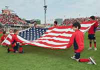 Kids hold the US flag during the opening ceremonies of an MLS game between the Philadelphia Union and the Toronto FC at BMO Field in Toronto on May 28, 2011..The Philadelphia Union won 6-2..