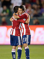 CARSON, CA – June 3, 2011: Chivas USA players Paulo Nagamura (5) and Marcos Mondaini (23) congratulate each other for the only goal of the game during the match between Chivas USA and Portland Timbers at the Home Depot Center in Carson, California. Final score Chivas USA 1, Portland Timbers 0.