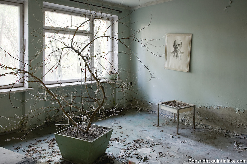 Drawing of Lenin with dead house plant in the hospital.<br /> <br /> Pripyat (Pripiat), 1km from the reactor, was designed as an exemplar of Soviet planning for the 50,000 people who worked at the Chernobyl Nuclear Power Plant in 1986 the result was the worst nuclear accident in history. Now a ghost town in Ukraine, Pripyat is in a radioactive exclusion zone unfit for human habitation for hundreds of years. This image was taken in 2007 over 5 hours, apparently the safe period of exposure.<br /> <br /> This image was exhibited at the Architectural Association, London in the exhibition &quot;Pripyat: 21 Years After Chernobyl, photographs by Quintin Lake&quot; 2008
