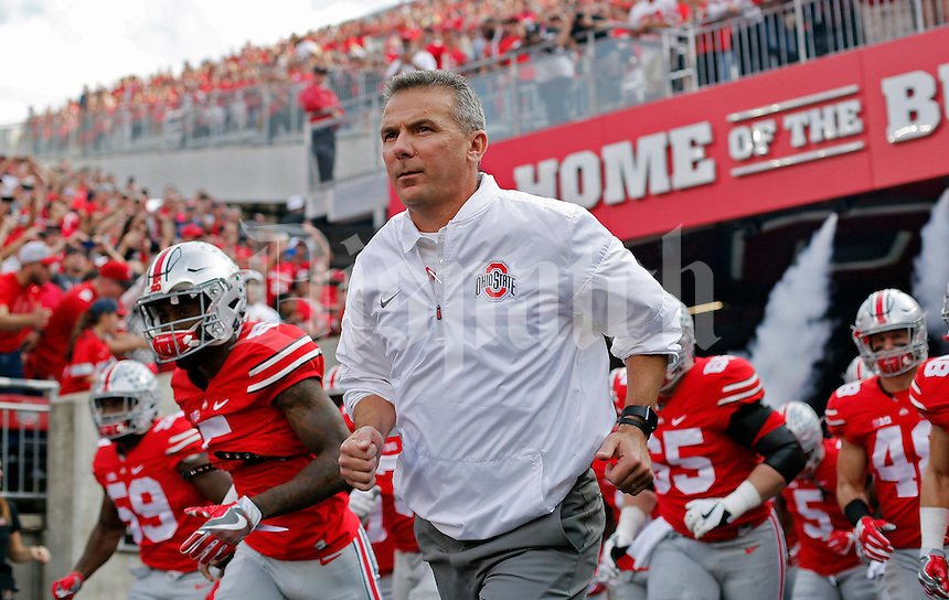 Ohio State Buckeyes head coach Urban Meyer and the Buckeyes head onto the field for their game against Northwestern Wildcats on October 29, 2016.  (Kyle Robertson / The Columbus Dispatch)