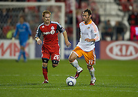 07 May2011: Houston Dynamo midfielder Brad Davis #11 and Toronto FC midfielder Matt Gold #26 in action during an MLS game between the Houston Dynamo and the Toronto FC at BMO Field in Toronto, Ontario..Toronto FC won 2-1.