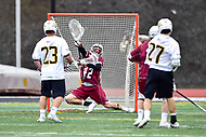 Towson, MD - May 6, 2017: Towson Tigers Mike Lynch (27) scores a goal vs UMASS Minutemen D.J. Smith (42) during CAA Championship game between Towson and UMASS at Minnegan Field at Johnny Unitas Stadium  in Towson, MD. (Photo by Phillip Peters/Media Images International)