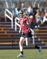 Harvard University midfielder Audrey Todd (21) on the attack.