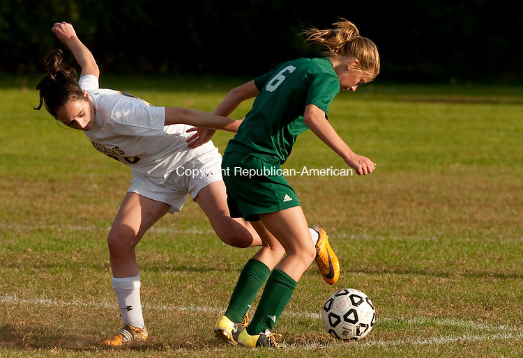 WATERBURY, CT--- -102115JS12---Chase's Malina Lacapra (6)  and Ethel Walker's Caroline Castonguay (23) battle for the ball during their game Wednesday at Chase Collegiate School in Waterbury. <br /> Jim Shannon Republican-American