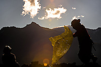 Pallaqueras, female gold miners, search for gold on a load of waste rock from the gold mines in La Rinconada, Peru, 4 August 2012. During the last decade, the rising price of the gold has attracted thousands of people to La Rinconada in the Peruvian Andes. At 5300 metres above sea level, nearly 50.000 people work in the gold mines and live in the nearby colonies without running water, sewage system or heating service. Although the work in the mines is very dangerous (falling rocks, poisonous gases and a shifting glacier), the majority of miners have no contract and operate under the cachorreo system - working 30 days without payment and taking the gold they supposedly find the 31st day as the only salary. In spite of a demaged environment, caused by mercury contamination from the mining and the lack of garbage disposal, people continue to flock to the region hoping to find their fortune.