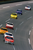 TALLADEGA, AL - MAY 1: Bill Elliott leads a group of cars through the tri-oval in the Harry Melling Ford during the Winston 500 NASCAR Winston Cup race at the Talladega Superspeedway near Talladega, Alabama, on May 1, 1988.