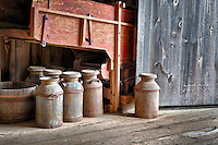 Antique milk cans in the round barn at Hancock Shaker Village.