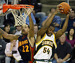 Seattle SuperSonics' Chris Wilcox hauls down a rebound from Golden State Warriors' Matt Barnes in NBA basketball actionin the fourth period Sunday, Dec. 10, 2006 in Seattle. The SuperSonics beat the Warriors 117-115. (AP Photo/Jim Bryant)