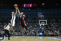 Basketball - NBA - New Jersey Nets vs. Toronto Raptors..Sundiata Gaines of the Nets shoots for a 3 over Jerryd Bayless of the Raptors at the O2, London.