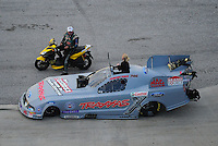 Jan. 21, 2012; Jupiter, FL, USA: Aerial view of NHRA funny car driver Courtney Force talking to father John Force during testing at the PRO Winter Warmup at Palm Beach International Raceway. Mandatory Credit: Mark J. Rebilas-