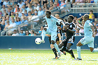 Kansas City forward Kei Kamara controls the ball in front of Simon Dawkins... Sporting Kansas City defeated San Jose Earthquakes 2-1 at LIVESTRONG Sporting Park, Kansas City, Kansas.