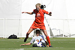 7 November 2007: North Carolina's Casey Nogueira (54) wins the ball between the legs of Clemson's Molly Johnson (21). The University of North Carolina defeated Clemson University 3-0 at the Disney Wide World of Sports complex in Orlando, FL in an Atlantic Coast Conference tournament quarterfinal match.