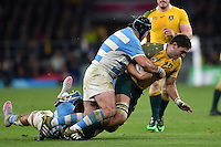 Rob Simmons of Australia is tackled by Marcos Ayerza of Argentina. Rugby World Cup Semi Final between Argentina v Australia on October 25, 2015 at Twickenham Stadium in London, England. Photo by: Patrick Khachfe / Onside Images