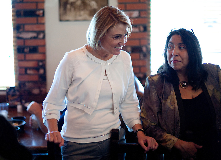 UNITED STATES - SEPTEMBER 1: Kate Marshall, left, Democratic candidate for Nevada's 2nd Congressional district , speaks with Vicenta Montoya, chair of Nevada's Si Se Pueda Latino Democratic Caucus, and other members of the group's lunch at the Viva Zapata restaurant in North Las Vegas on Thursday, Sept. 1, 2011. Marshall is running against Republican Mark Amodei in a special election on Sept. 13, 2011, to fill Dean Heller's seat after he was appointed to the U.S. Senate. (Photo By Bill Clark/Roll Call)