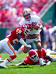 KANSAS CITY - CIRCA 1990's:  Steve Young of the San Francisco 49'ers in action during an NFL game against the Kansas City Chiefs at Arrowhead Stadium in Kansas City, Missouri.  (Photo by Ron Vesely)