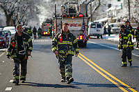 NYFD officers attend a fire alarm where at least 7 children died during the fire in Brooklyn, New York. 21.03.2015. Eduardo Munoz Alvarez/VIEWpress.