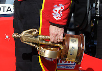 May 15, 2016; Commerce, GA, USA; Detailed view of the Wally trophy in the hand of NHRA top fuel driver Doug Kalitta as he celebrates after winning the Southern Nationals at Atlanta Dragway. Mandatory Credit: Mark J. Rebilas-USA TODAY Sports