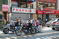 Motorcyclists wait for a light to change on Flushing Avenue in the busy Graham Avenue CBD in the Bushwick neighborhood of Brooklyn in New York on Sunday, June 2, 2013. As more and more hipsters move into the neighborhood the ethnicity of the area is changing.   (© Richard B. Levine)