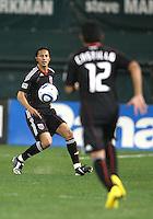Juan Manuel Pena #3 of D.C. United passes to Cristian Castillo #12 during an MLS match against the New England Revolution on April 3 2010, at RFK Stadium in Washington D.C.